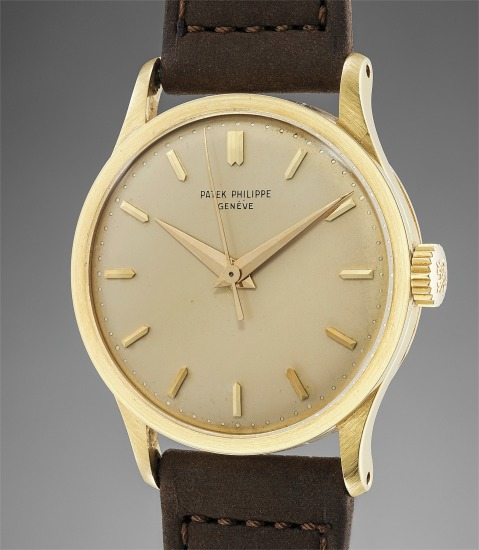 A rare and extremely well-preserved yellow gold wristwatch with center seconds and champagne dial