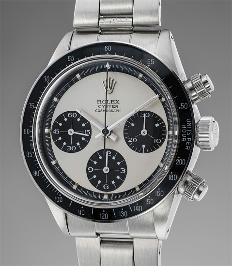 """A very well-preserved and extremely rare stainless steel chronograph wristwatch with Mark 2 """"Paul Newman"""" dial and bracelet with original guarantee and box"""