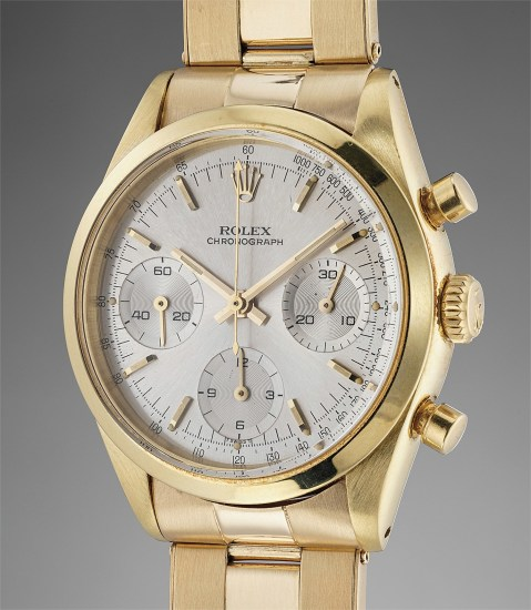 A rare, attractive and well preserved yellow gold chronograph wristwatch with silvered dial and bracelet
