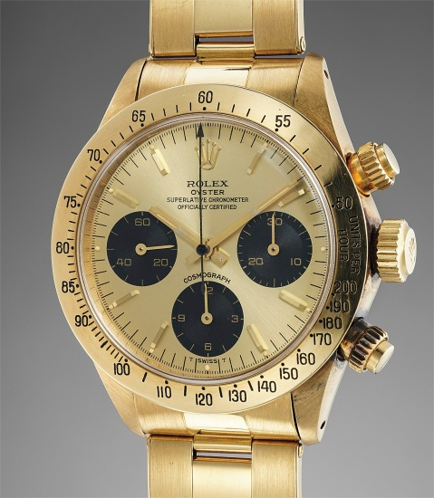 A very rare and attractive yellow gold chronograph wristwatch with bracelet