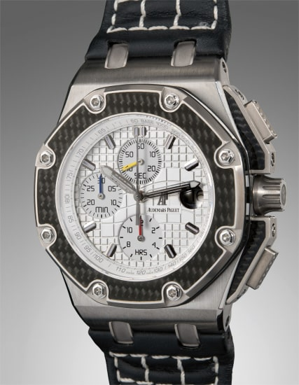A rare and well-preserved limited edition titanium chronograph wristwatch with date and tachymeter bezel, numbered 31 of 1000, accompanied with boxes, papers, and original guarantee
