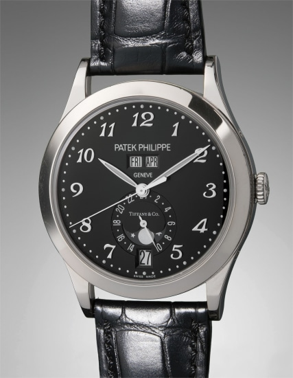 A very fine and rare white gold limited edition annual calendar wristwatch with moon phases, Breguet numerals, and original accessories, made to commemorate the fifth anniversary of the Patek Philippe boutique at Tiffany & Co. New York