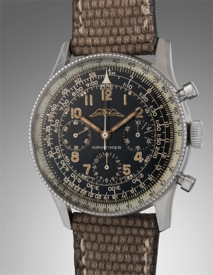 An early, very rare and highly attractive stainless steel pilot's chronograph wristwatch with black gilt dial and slide rule bezel