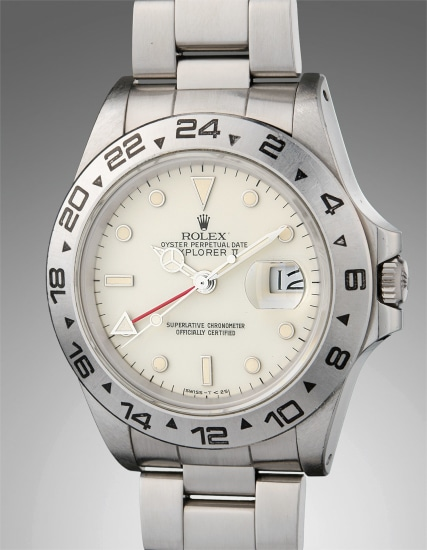"""A very rare stainless steel dual time wristwatch with date, cream """"rail"""" dial, and bracelet"""