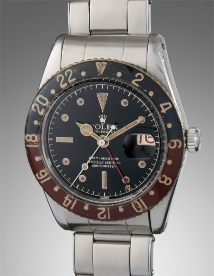 A rare and well-preserved stainless steel dual time wristwatch with Bakelite bezel and bracelet