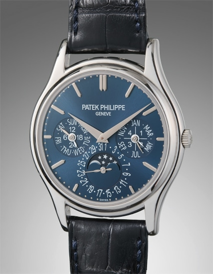 A very fine and rare platinum perpetual calendar wristwatch with blue dial and moon phase, certificate of origin, and presentation box