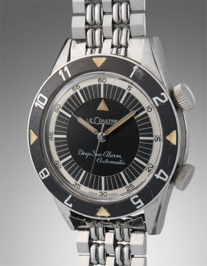 A very fine and extremely rare stainless steel diver's wristwatch with alarm function, bracelet, guarantee, and presentation boxes