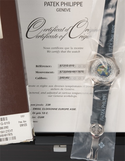A very fine and rare white gold world time wristwatch with cloisonné enamel dial in factory seal, with original fitted presentation box and certificate of origin