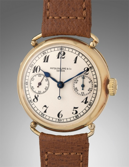 An extremely rare and highly attractive yellow gold single button chronograph wristwatch with hinged officer-style wire lug case and Breguet numerals