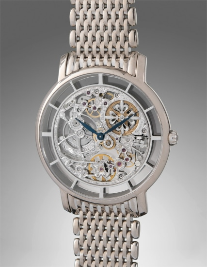 A very fine, attractive, and rare white gold skeletonized wristwatch with bracelet