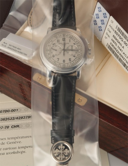 A very fine, rare, and oversized white gold chronograph wristwatch with certificate of origin, paperwork, and box, single sealed