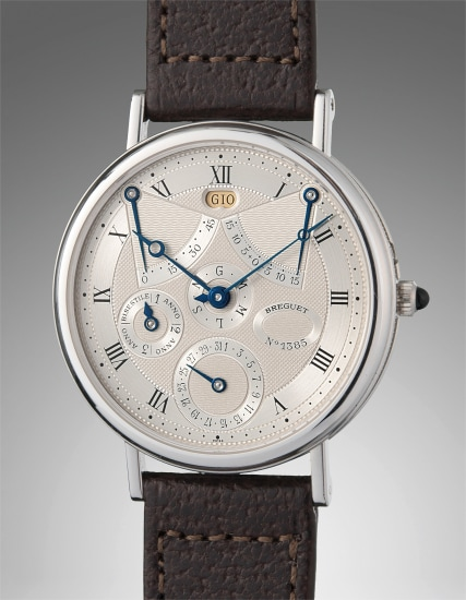 An extremely fine and very rare platinum perpetual calendar wristwatch with power reserve and equation of time
