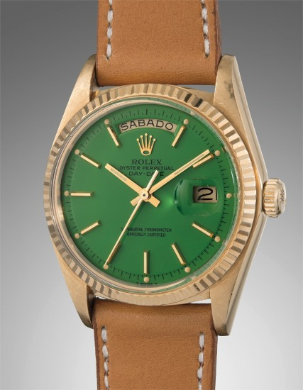 """A rare and very attractive yellow gold calendar wristwatch with green lacquer """"Stella"""" dial"""