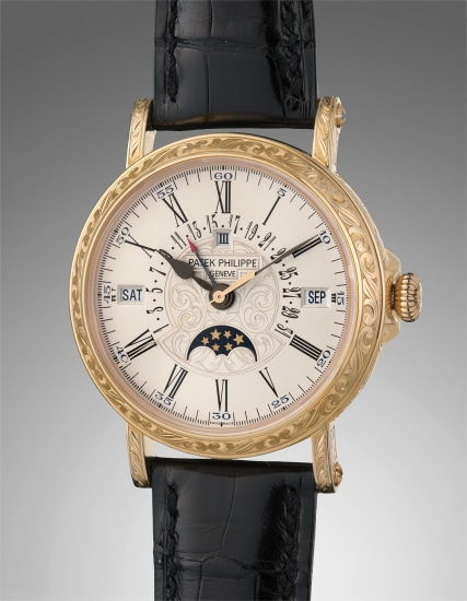 """An extremely fine and very rare yellow gold perpetual calendar wristwatch with retrograde date, moon phase and leap year, with hand engraved """"officer""""-style case, accompanied with certificate of origin and presentation box"""
