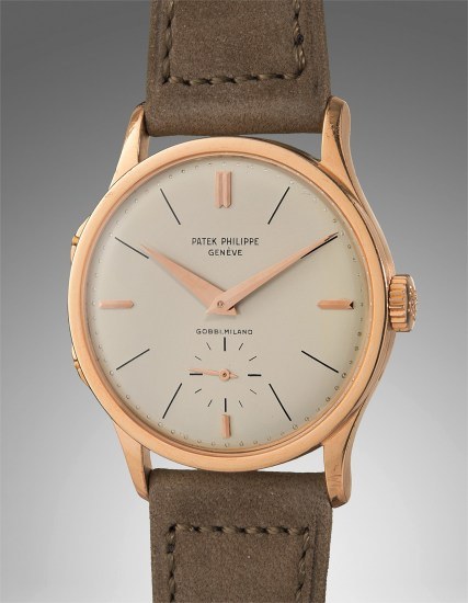 An important, extremely rare, well-preserved, and highly attractive pink gold dual time wristwatch with separately adjustable hour hand, retailed by Gobbi, Milano