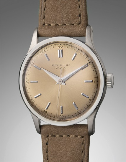 A very fine, rare and elegant oversized white gold wristwatch with sweep center seconds and champagne dial