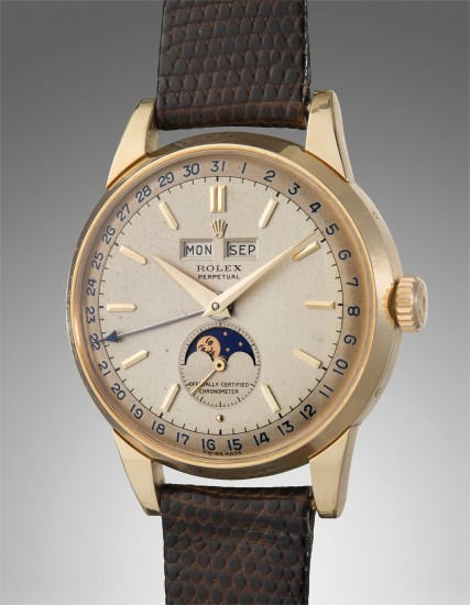 An extremely rare, highly attractive, and well-preserved yellow gold triple calendar wristwatch with moon phases and two-tone dial