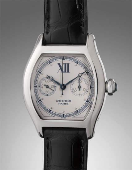 A fine and attractive white gold tonneau-shaped monopusher chronograph wristwatch with certificate and presentation box