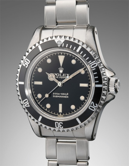 An early, very attractive and well-preserved stainless steel diver's wristwatch with glossy gilt dial, bracelet, and pointed crown guards