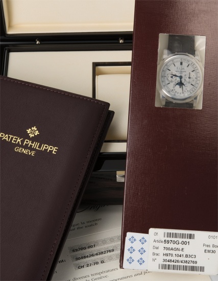 A fine and rare white gold perpetual calendar chronograph wristwatch with moon phase, certificate of origin and fitted presentation box, factory double sealed