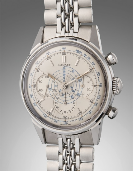 A very attractive and well-preserved stainless steel chronograph wristwatch with blue tachymeter scale and bracelet