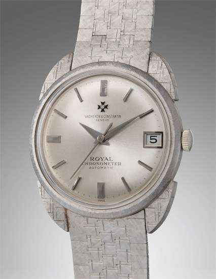 A very rare and exquisite white gold wristwatch with date, unusual lugs and bracelet