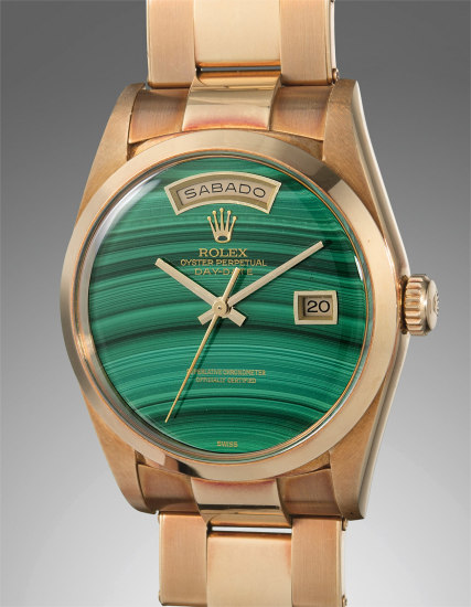 A very rare and highly attractive yellow gold calendar wristwatch with malachite hardstone dial and bracelet