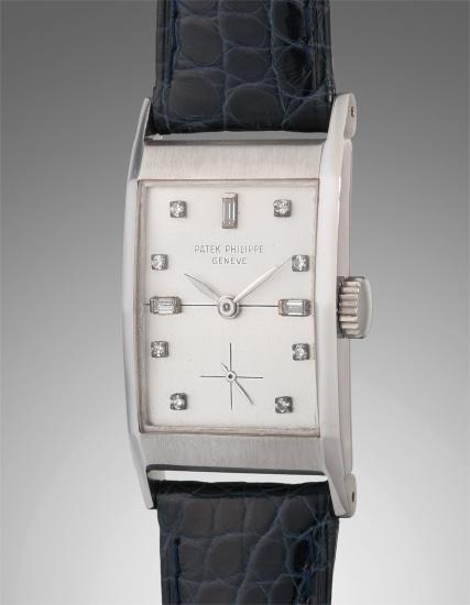 A rare and attractive platinum and diamond-set rectangular-shaped wristwatch