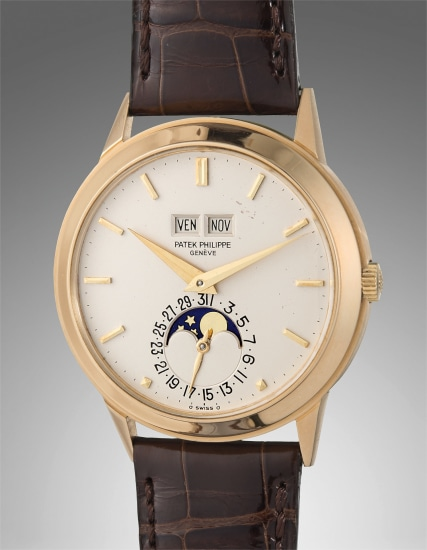 A very fine and rare yellow gold perpetual calendar wristwatch with moon phases