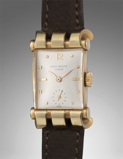 A rare and very fine yellow gold rectangular-shaped wristwatch with fancy scrolled lugs