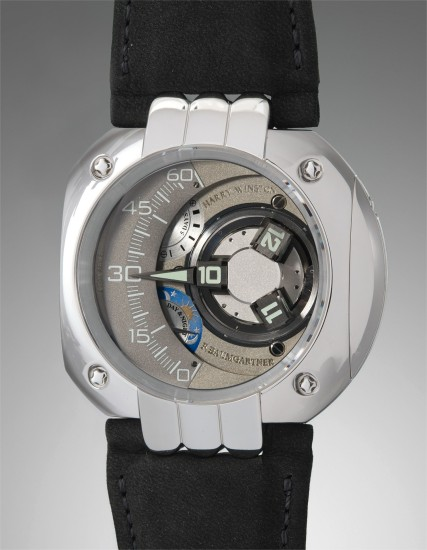 A rare and unusual limited edition platinum wristwatch with three dimensional satellite hour display, retrograde minutes, five day power reserve and day and night indication, and five year service indicator