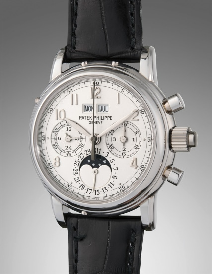 A fine and rare platinum perpetual calendar split-seconds chronograph wristwatch with moon phase, certificate of origin, and additional caseback