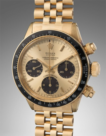 "An important, very rare, and well-preserved yellow gold chronograph wristwatch with champagne dial displaying small ""Oyster"" designation and ""floating scripts"", accompanied by original boxes and guarantee"