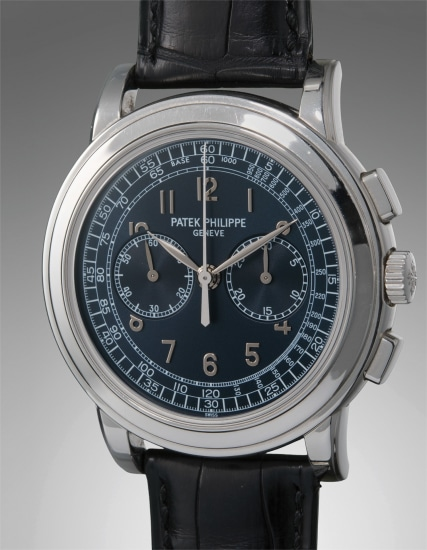 A very fine, rare, and large platinum chronograph wristwatch with original certificate of origin, paperwork, and fitted box