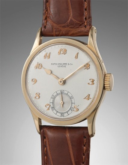 A rare and attractive yellow gold wristwatch with Breguet numerals