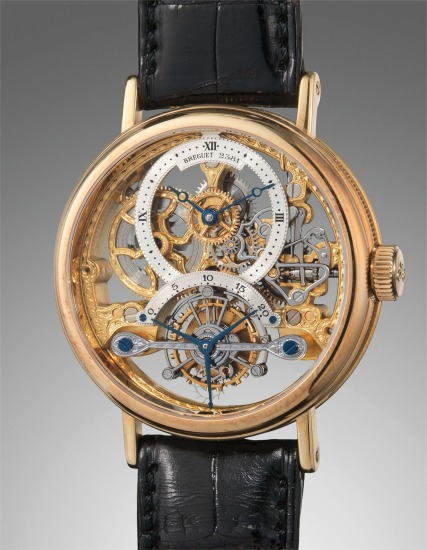 A fine and attractive yellow gold skeletonized tourbillon wristwatch with presentation box