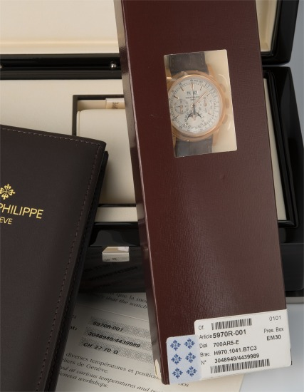 A very fine and rare pink gold perpetual calendar chronograph wristwatch with moon phase, certificate of origin and fitted presentation box, factory double sealed