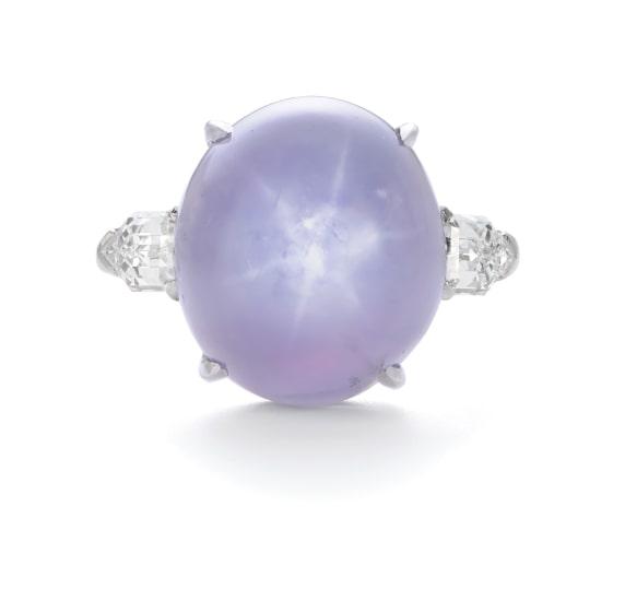 A Ceylon Star Sapphire and Diamond Ring