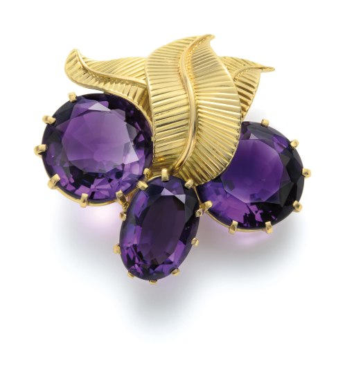 A Gold and Amethyst Brooch/Pendant