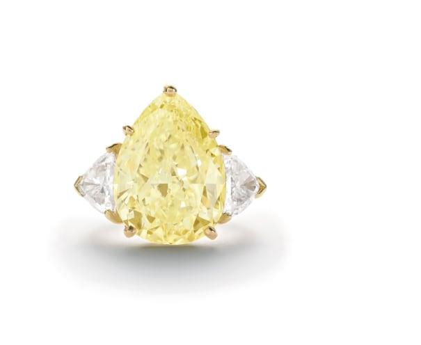 An Impressive Fancy Intense Diamond and Diamond Ring