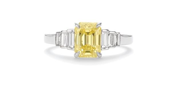 A Fancy Intense Diamond and Diamond Ring
