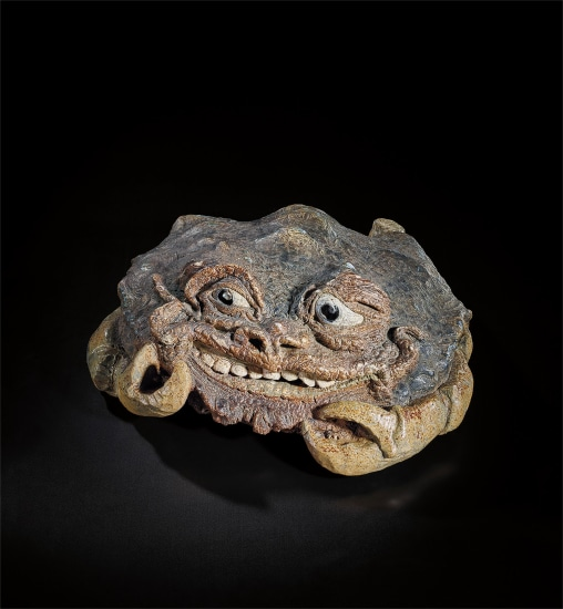 Colossal and extraordinary grotesque grinning crab