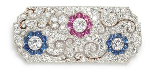 An Art Deco Diamond, Ruby and Sapphire Brooch