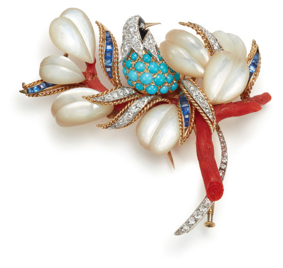 A Diamond, Sapphire, Turquoise, Mother-of-Pearl, Coral, and Onyx Brooch