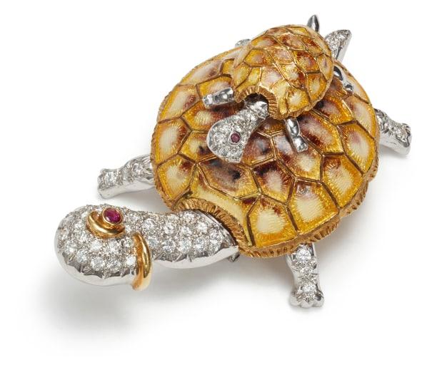 A Diamond, Enamel and Ruby Brooch