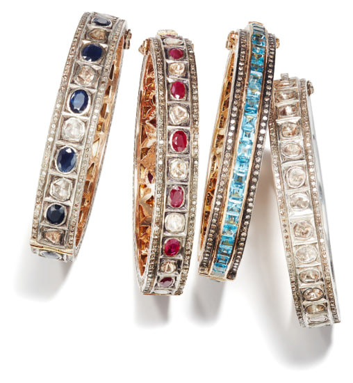 A Set of Diamond, Sapphire, Ruby and Topaz Bangle Bracelets