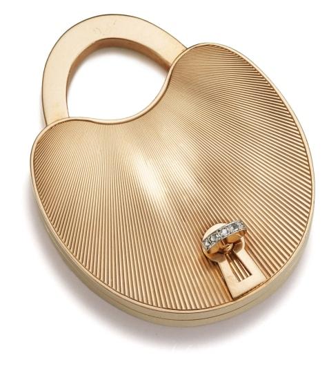 A Gold and Diamond Padlock Compact