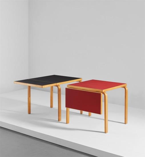 "Pair of rare extendable ""L-leg"" tables"