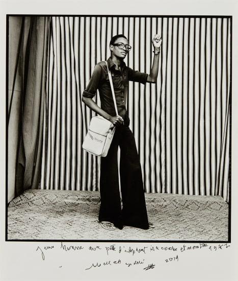 Jeune Homme, pattes d'elephant, avec sacoche et montre, 1977