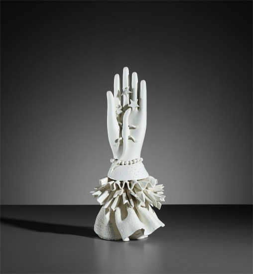 Hand with lizard statuette